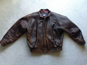 Real Leather... Brown.. Distressed patina finish.. Size L