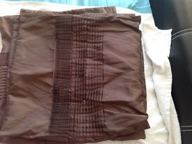 4 brown cushions with covers