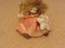 MUSICAL WIND-UP DOLL