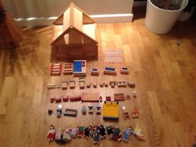 Wooden dolls house with dolls & furniture