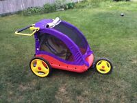 Ride along chariot/stroller/jogger. Sits 2 kids.