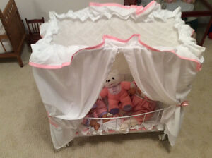 Canopy doll bed on casters Moose Jaw Regina Area image 1