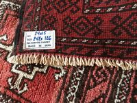 Red patterned rug made in Iran