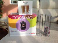 Unopened Tassimo VIVI Coffee maker with Intellibrew. 2 Latte glasses and a wire coffee sachet holder