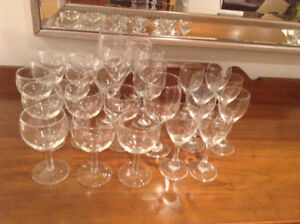 27 wine glasses of different sizes and shapes
