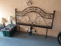 Antique rot iron headboard finished in mat black with matching table lamps