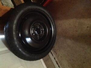 Pontiac Sunfire Donut spare tire. Windsor Region Ontario image 1