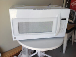 Over the range Microwave with exhaust fan. Like new