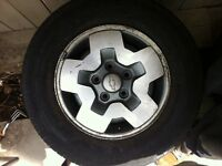 Set of 4 chev rims with rubber. 225/70/r15