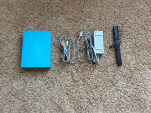 Nintendo Wii with 5 games, 4 remotes, and many more items