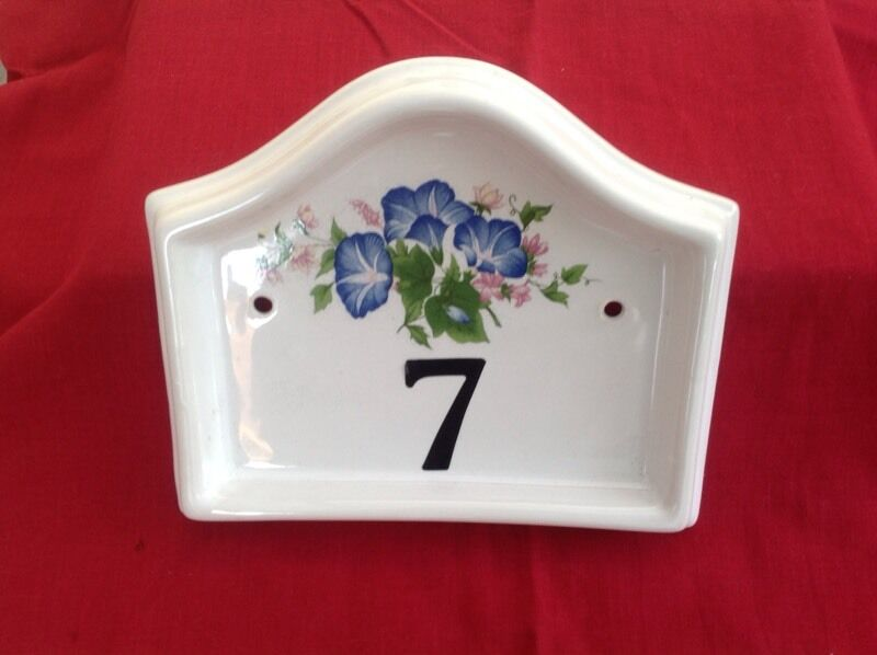 12 individual boxes of ceramic wall plaques all with blue primrose design