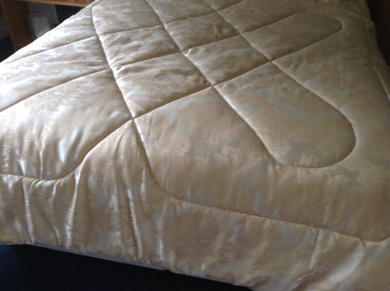 Gold quilted bedspread valance and matching pillow cases