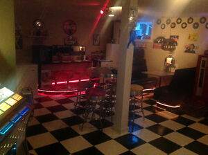 1960's retro diner with juke box, working coke machine, soda bar