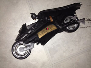 Batman on motorbike - shoots 2 little rockets