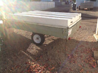6 x 8 ft. Utility trailer with a cover.