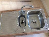 Kitchen sink with mixer taps