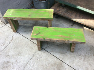 2 rustic looking benches made from reclaimed wood