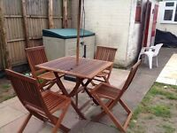 Wooden garden furniture with sun brolly