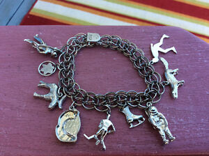 Vintage 1970's Stirling Silver Charm Braclet with 9 Charms