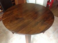 Dark wood round extendable table