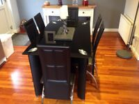 Black dining room table and 6 chairs