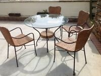 4 wicker garden chairs and table