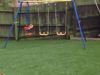 Childrens swing and seesaw