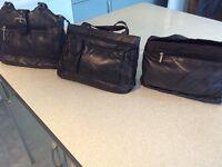 Three ladies black leather handbags
