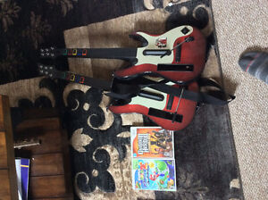 Guitar hero with two guitars and super Mario Galaxy 2