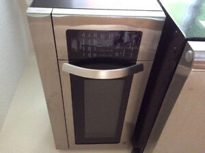 LG Hood fan microwave combo in stainless