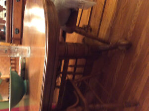 Solid wood.  Excellent condition