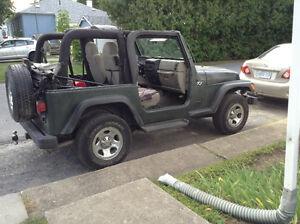 2003 Jeep TJ 6 cylinder 5 spd.