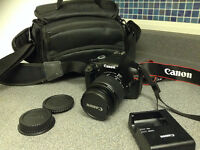 Canon EOS Rebel T3 camera with camera bag and accessories
