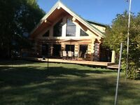 REDUCED price on LAKEFRONT LOG HOME $670,000.00 o.b.o.