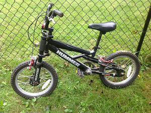 Nice kids bike with shocks ,bmx  good solid bike for 20 dollars
