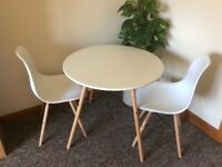 "Contemporary ""Coava"" cream dining table and 2 chairs"