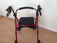Folding walker with seat