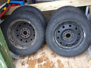"""Four 15"""" studded winter tires with rims St. John's Newfoundland image 1"""