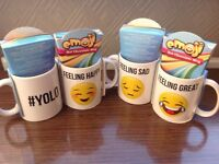 Emoji mugs with chocolate mix drink