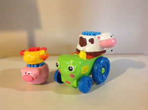 Tracteur et animaux empilables Fisher Price