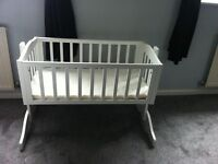 White swinging crib with mattress