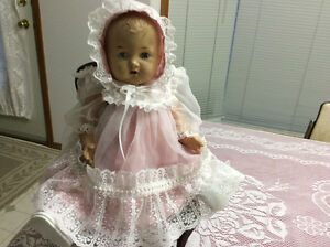 This doll is in mint condition and is about 100 years old