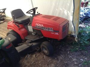 19 hp Noma lawn tractor with mower and push blade