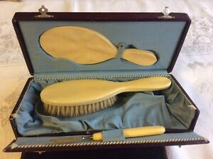 Antique boxed 3 piece mirror, brush set