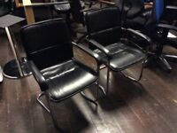 2x leather look chairs