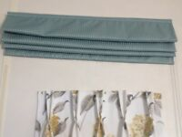 Curtains and Roman blinds.