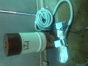 Vacuum canister and new hose for in wall central vacuuming.