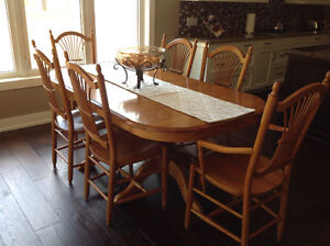 Solid wood dining table seats four up to twelve