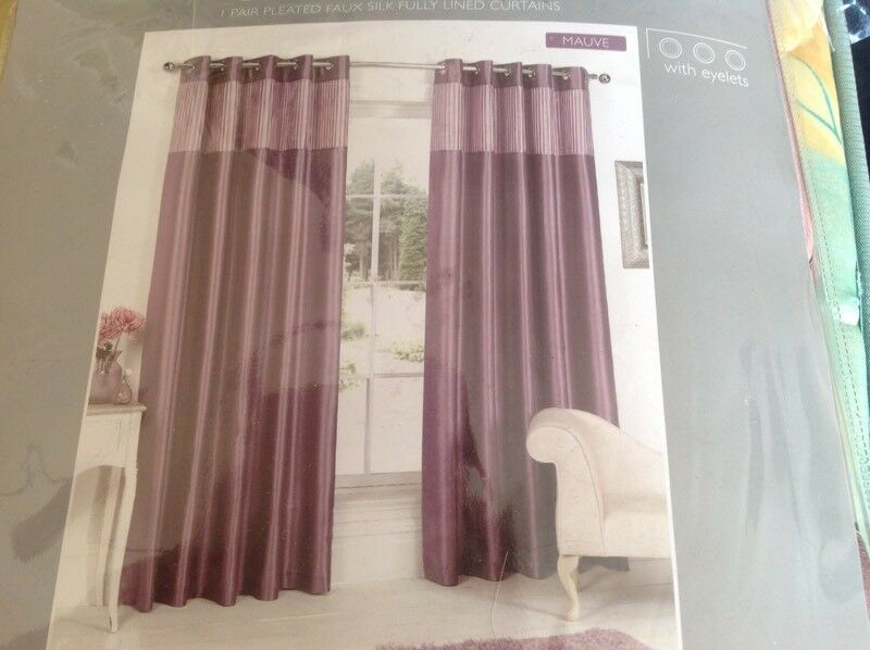 Brand new in packaging, two pairs of faux silk fully lined curtains 66x72