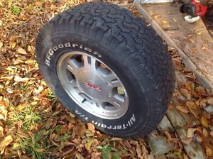 4 tires and GMC Rims.LT 245-75-R16